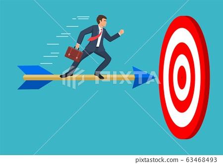 Businessman aim arrow to target. 63468493