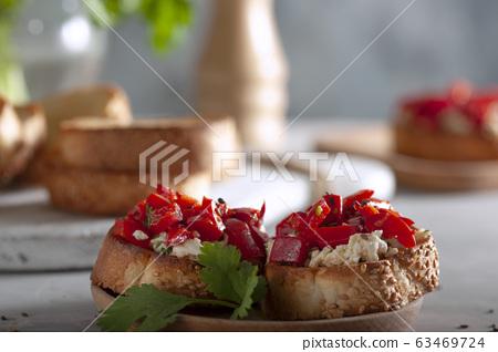 Delicious bruschetta for breakfast. 63469724