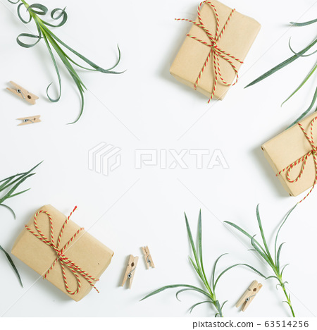 Gift boxes with floral decoration. Flat lay, top view, copy space 63514256