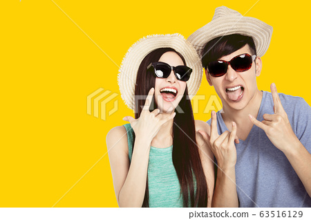 excited young couple  having fun in summer  dress 63516129