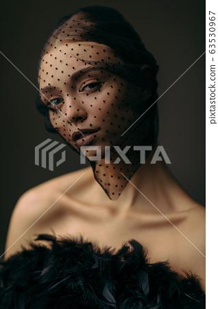 beauty elegant girl posing in black veil 63530967
