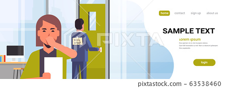 businesswoman luaghing sticky note with text kick me on back of businessman april fools day concept modern office interior horizontal copy space portrait 63538460