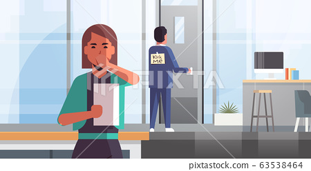 businesswoman luaghing sticky note with text kick me on back of businessman april fools day concept modern office interior horizontal 63538464