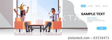 first april fool day mix race businesspeople couple wearing funny jester hat glasses nose mustache holiday celebration concept modern office interior full length copy space horizontal 63538471