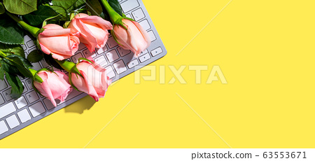 Computer keyboard with pink roses 63553671