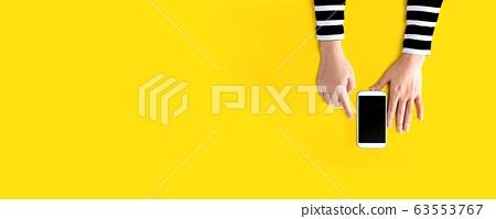 Person using a white smartphone 63553767