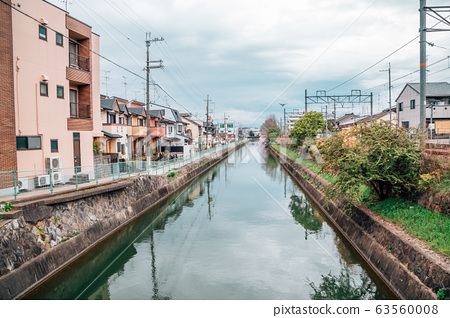 Residential buildings and river at spring day in Kyoto, Japan 63560008