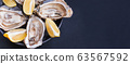 Banner with raw opened oysters with ice and lemon slices 63567592