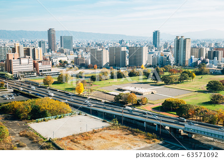 Modern buildings and overpass road at autumn in Osaka, Japan 63571092