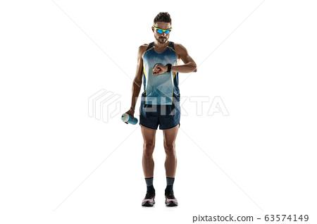 Triathlon male athlete running isolated on white studio background 63574149