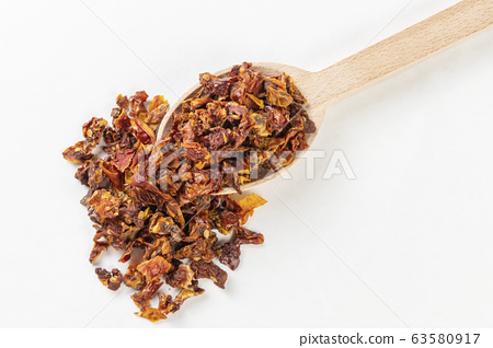 dried tomatoes in wooden spoon isolated on white 63580917