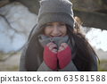 Pretty young woman with grey eyes posing on sunny day outdoors. Joyful Caucasian girl smiling at camera at the background of autumn park. Lifestyle, happiness, leisure. 63581588