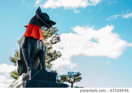 Fox statue at Fushimi Inari shrine in Kyoto, Japan 63589046