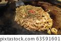 Japanese yaki soba on a iron plate ready to serve 63591601