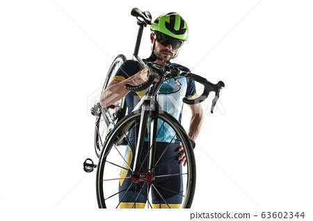 Triathlon male athlete cycle training isolated on white studio background 63602344