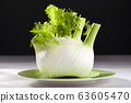 Fresh raw fennel on a plate with a black 63605470