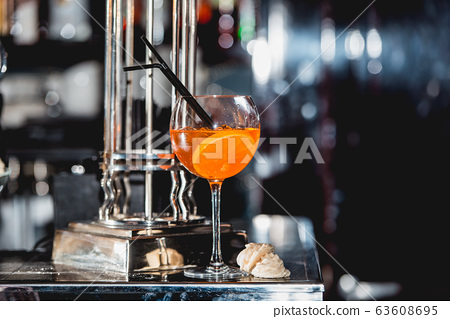 glass of refreshing orange alcoholic cocktail on a 63608695