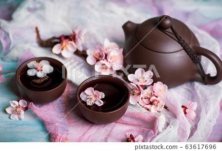 Tea set and spring cherry blossom flowers 63617696