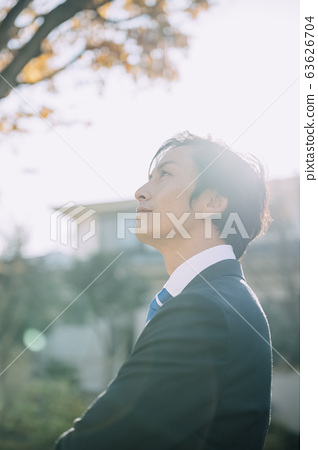Businessman in the park 63626704