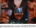 Glass of alcohol close up. 63629594