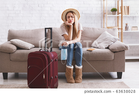 Travel cancel and sad woman stay at home 63638028