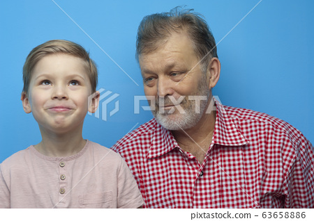 Portrait of cute positive grandfather and grandson 63658886