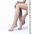 Beautiful legs and hand on a white background 63665667