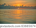 sunset and siluet of fisherman very far away 63665674