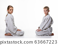 A girl and a boy in a sports kimono sit opposite 63667223