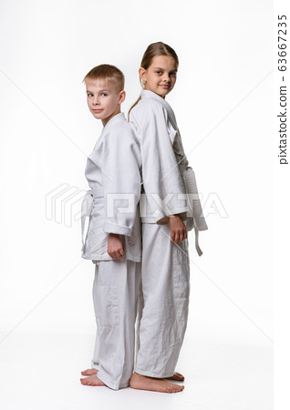 Boy and girl in sports kimono stand with their 63667235
