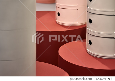 Closeup view at fancy multicolored cylindrical constructions 63674191