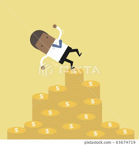 African businessman falling of money mountain. 63674719