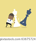 African businessman moving giant white chess piece against other chess piece. 63675724
