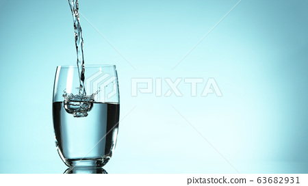 Freeze motion of pouring water into glass 63682931