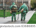 COVID-19 outbreak. Military people in bio viral hazard protective suits prepaire of chemicals for 63686895