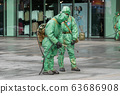 Military disinfects floor and surfaces from coronavirus. Antibacterial sanitary measures on 63686908