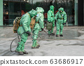 Military disinfects floor and surfaces from coronavirus. Antibacterial sanitary measures on 63686917