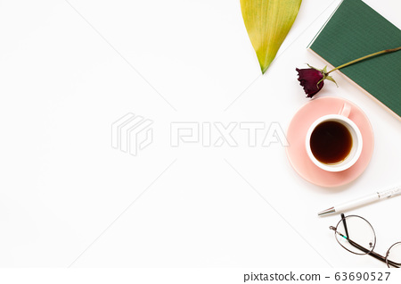 Work and study place. note book, cup of coffee, pen, glasses with floral decoration. flat lay, top view, copy space 63690527