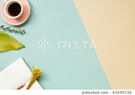 Work and study place. note book, cup of coffee with floral decoration. flat lay, top view, copy space 63690536