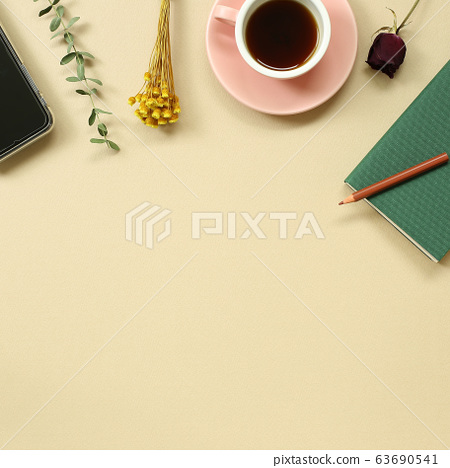Work and study place. note book, cup of coffee, smart phone with floral decoration. flat lay, top view, copy space 63690541