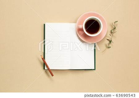 Open note book with cup of coffee on beige background. flat lay, top view, copy space 63690543
