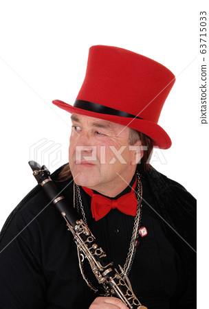 A clarinet player with a red hat and black outfit 63715033