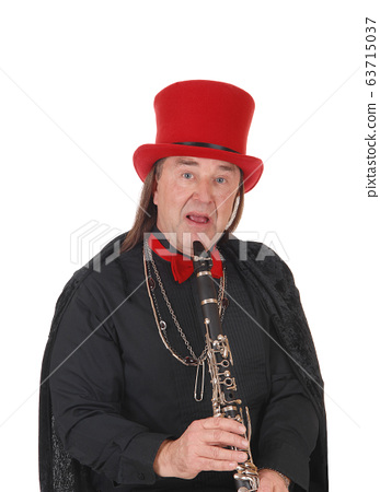 A clarinet player with a red hat and black outfit 63715037