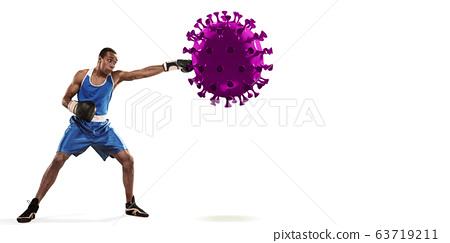 Professional sportsman kicking, punching coronavirus model - fight the desease, flyer 63719211