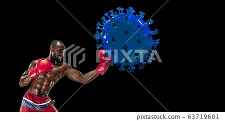 Professional sportsman kicking, punching coronavirus model - fight the desease, flyer 63719601