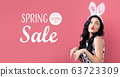 Spring sale message with woman with Easter theme 63723309