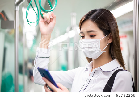 woman with mask in mrt 63732259