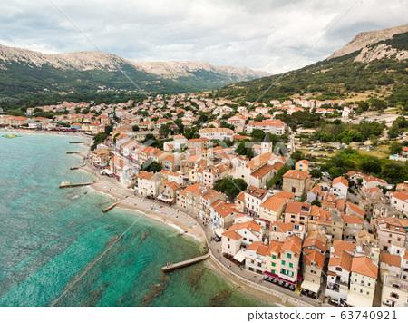 Aerial panoramic view of Baska town, popular touristic destination on island Krk, Croatia, Europe. 63740921