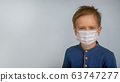 Child boy in medical mask. Concept of an epidemic, influenza, protection from disease, vaccination. 63747277
