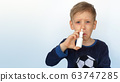 Child boy spraying medicine in nose against flu. Self-medicating, nose spray, health and care concept. 63747285